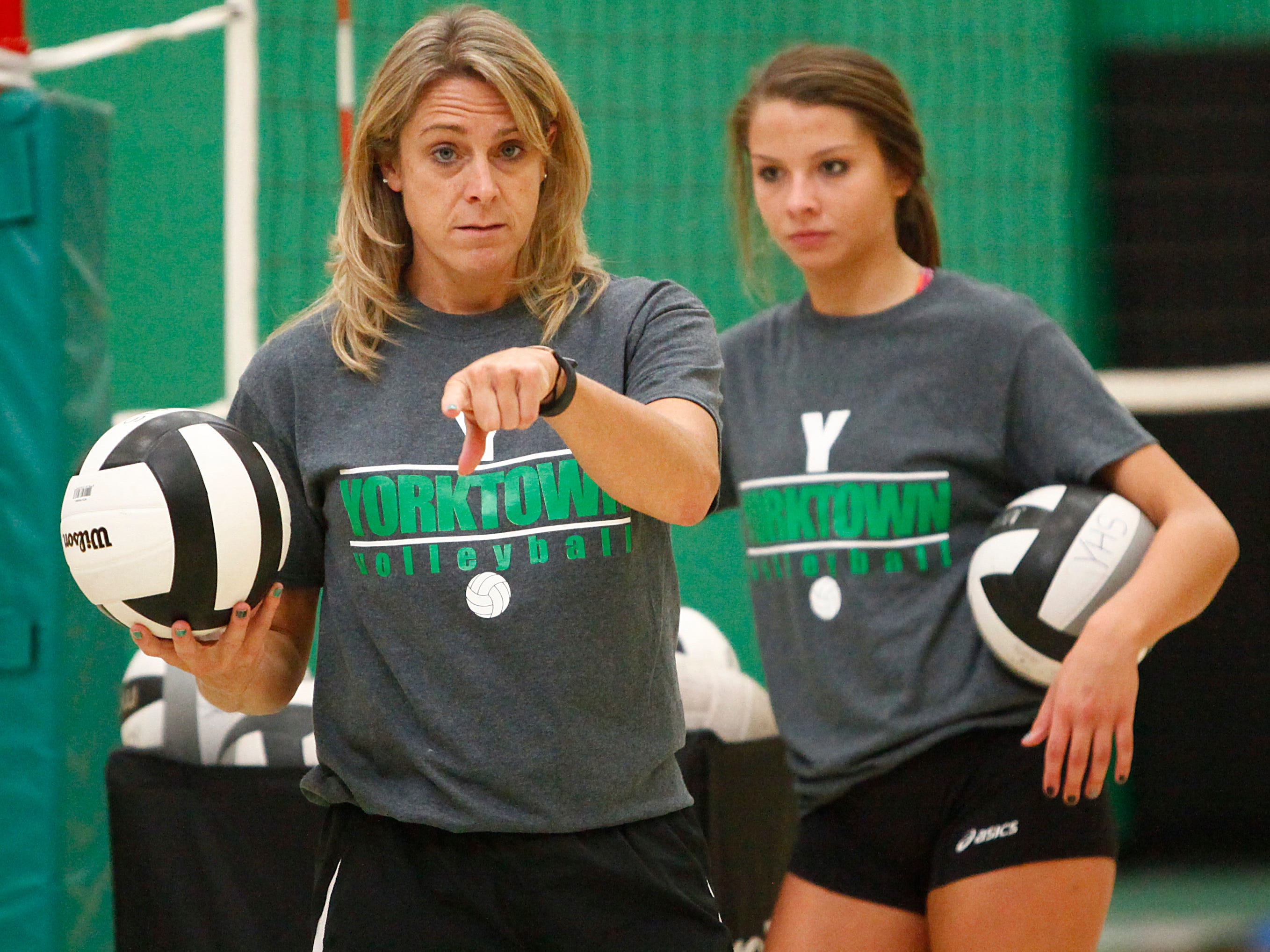 Yorktown's interim coach Rhonda Murr helps run the drills with some of her players during a practice on Wednesday. Yorktown will play Central on Thursday.