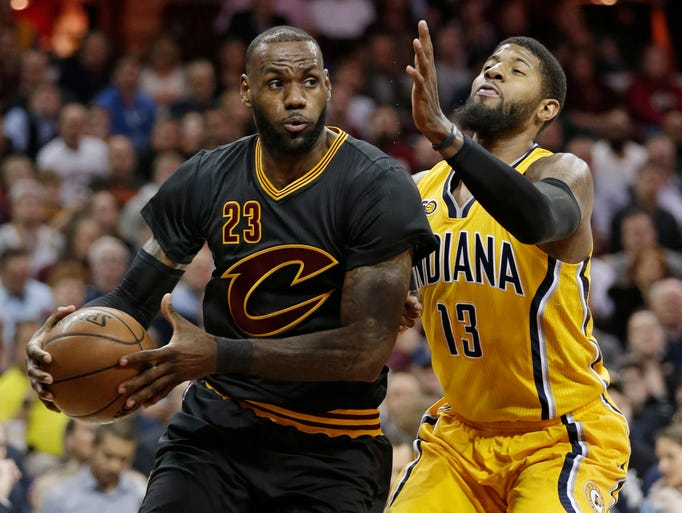 Cleveland Cavaliers' LeBron James (23) drives against