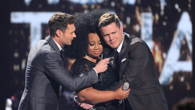 'American Idol' finalists La'Porsa Renae, center, and Trent Harmon, right, hug as Ryan Seacrest announces the final 'Idol' champion.