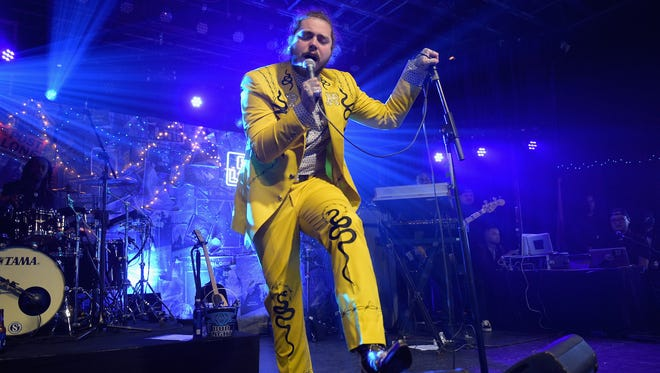 NASHVILLE, TN - APRIL 04:  Post Malone performs onstage for Bud Light's Dive Bar Tour at the Exit/In on April 4, 2018 in Nashville, Tennessee.  (Photo by Jason Kempin/Getty Images for Bud Light)