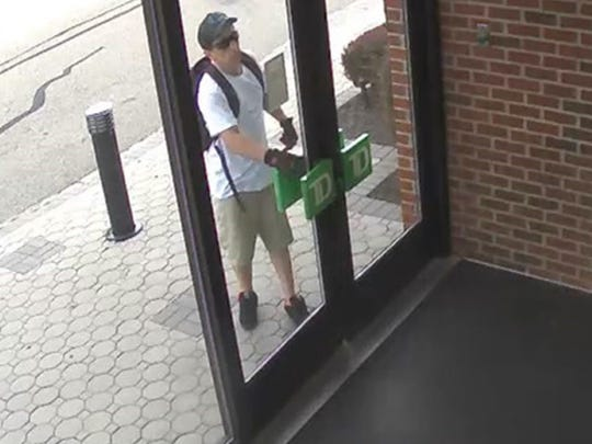 Surveillance photos released by authorities show a man suspected of robbing the TD Bank branch on Mount Hope Avenue in Rockaway township entering the branch.
