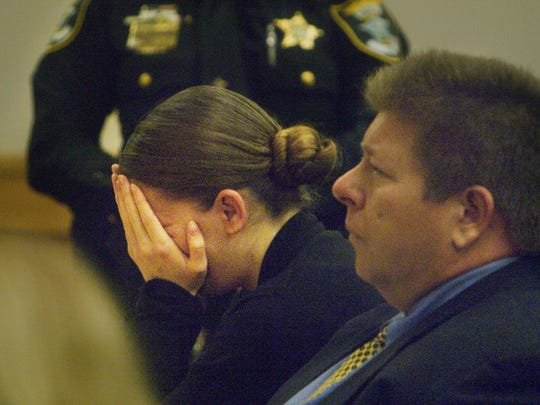 Ashley Toye reacts March 29, 2007 after being found guilty in the murders of Alexis and Jeffery Sosa on at the Lee County Justice Center. John Mills, right, is Toye's attorney.