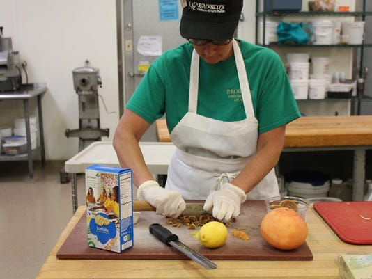 Amanda Coeyman from Browns Orchards and Farm experiments with a Trefoil Girl Scout Cookie recipe in preparation for Girl Scout in the Heart of Pennsylvania s third annual Fork It Over fundraiser.