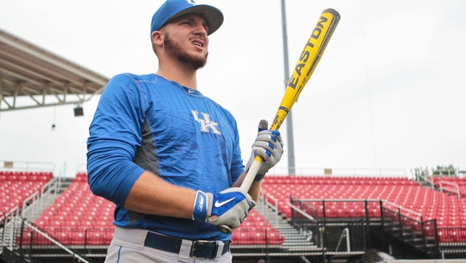 Kentucky's A.J. Reed was named Player of the Year by Collegiate Baseball magazine for his 2.10 earned-run average on the mound. Reed also leads the nation in home runs -- 23 -- more than 193 entire Division I teams âjQuery172024000818142667413_1401468849273 slugging percentage (.768) and OPS (1.259). He was practicing Thursday with his team in preparation for the Louisville NCAA Regional. May 29, 2014