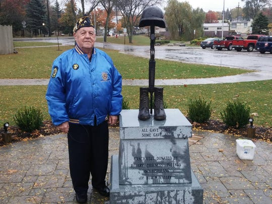Ron Nevorski of Milford, a member of the Friends of American Veterans board, poses for a photo after installation of the fallen soldier memorial in Central Park last week. Nevorski served with the U.S Marine Corps during the Korean War.