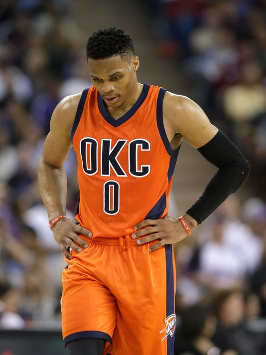 Oklahoma City Thunder guard Russell Westbrook walks down court in the closing moments of the Thunder's 114-112 loss to the Sacramento Kings in an NBA basketball game Saturday, April 9, 2016, in Sacramento, Calif. (AP Photo/Rich Pedroncelli)
