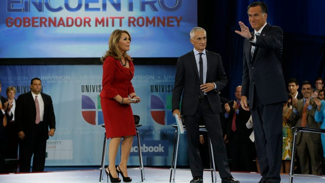 """Republican presidential candidate Mitt Romney participates in a Univision """"Meet the Candidates"""" forum in Miami in 2012."""