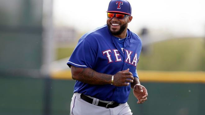 Texas first baseman Prince Fielder is enjoying his fresh start with the Rangers in training camp in Surprise, Ariz. The former Detroit Tigers slugger says he's lost a couple of pounds and cut his hair.