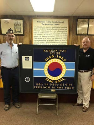 American Legion Burton-Cowell Post 265 Jacksonville Cmdr. Jerry Griffin recently presented a 50th Anniversary of the Korean War Commemoration Flag to the Jacksonville Vet Center.  Accepting the flag is retired SgtMaj Paul Siverson, Vet Center Veteran Outreach Program Specialist.