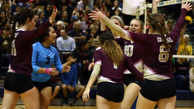 Tuloso-Midway celebrates after scoring against Alamo Heights during their Class 5A Regional Semifinal match at Dugan Wellness Center on Friday, Nov. 11, 2016. The Cherokees won in three sets and will play for a regional final on Saturday.