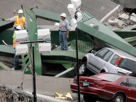 Inspectors examine the rubble of the Interstate 35W bridge on Aug. 4, 2007. The bridge collapsed over the Mississippi River in Minneapolis.