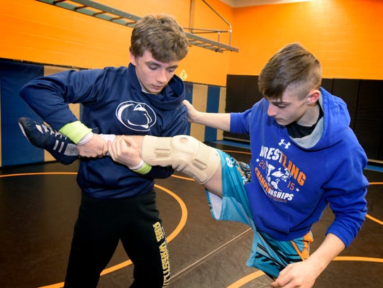 Northeastern wrestlers Cole Wilson and Thomas Gradwell, left, wrestle at the school last year. Both are hoping to make postseason runs in 2019.