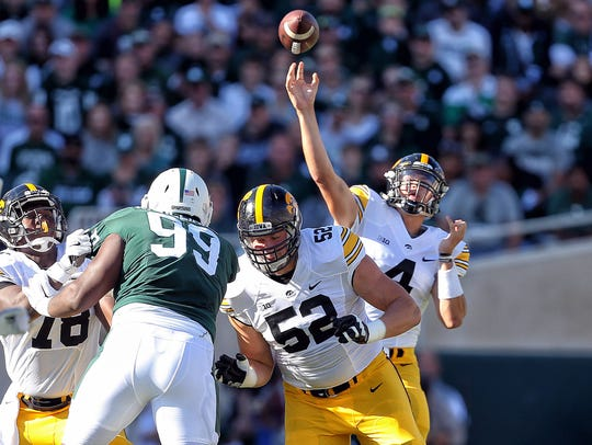 Iowa Hawkeyes quarterback Nathan Stanley attempts to