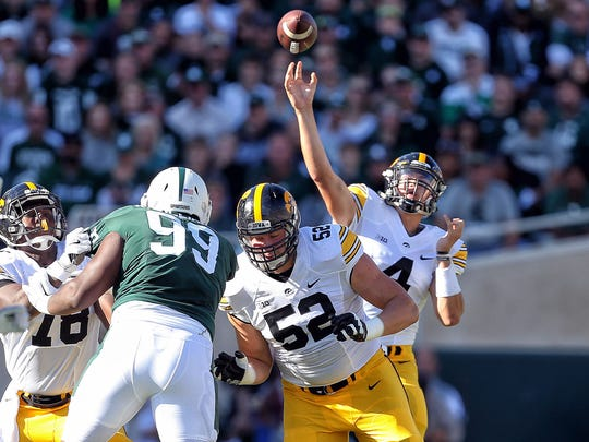 Iowa Hawkeyes quarterback Nathan Stanley attempts to throw the ball during the first quarter of a game against the Michigan State Spartans at Spartan Stadium.