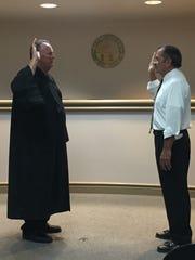 Cheviot Mayor Samuel Keller swears in new chief of police Emmett Stone June 4.