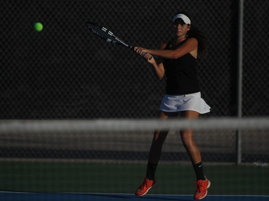 Chiles' Gracie Wilson plays a backhand during doubles