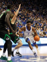 Kentucky Wildcats guard Hamidou Diallo (3) dribbles the ball against Utah Valley Wolverines forward Isaac Neilson (22) In the first half at Rupp Arena in Lexington, Kentucky, on Friday, Nov. 10, 2017.