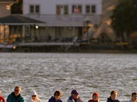 Members of the Pensacola Rowing Club row across Bayou Texar Saturday morning. The group is helping to put together the first International Coastal Rowing tournamnet in the United States at Pensacola Beach.