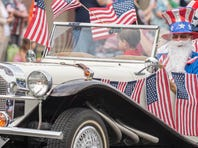 Four-year-old John Phillip Eiler shows his support during the Memorial Day Parade in Marshall on Monday.