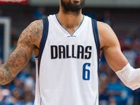 April 26, 2015; Dallas; Dallas Mavericks center Tyson Chandler (6) grabs the ball in front of Houston Rockets guard Corey Brewer (33) and center Dwight Howard (12) during Game 4 of the first round of the NBA playoffs at American Airlines Center.