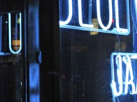 The Blue Wisp jazz club's iconic neon sign is among the items up for grabs to the highest bidder.