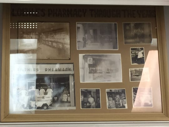 An old picture frame at Loehle Pharmacy displays black and white photos from the drugstore's early days.