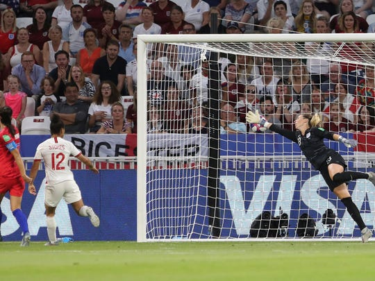 United States' Alex Morgan, left, scores her side's second goal during the Women's World Cup semifinal soccer match between England and the United States, at the Stade de Lyon outside Lyon, France, Tuesday, July 2, 2019. (AP Photo/Laurent Cipriani)