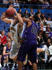 Augie's  Al Richter gets fouled by USF's Saajid Polite