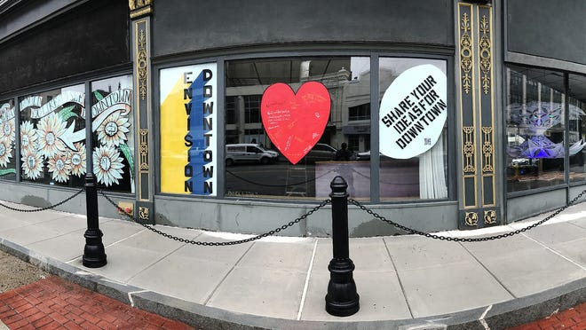 Artists have filled the storefront windows of 554 Main St., Worcester, across from the Hanover Theatre for the Performing Arts, with interactive art installations.