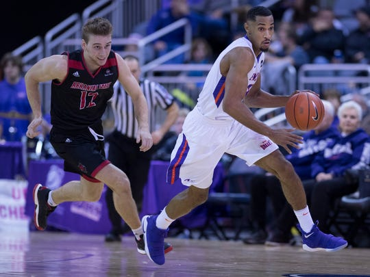 Evansville's Ryan Taylor outruns Arkansas State's Connor Kern (12) at the Ford Center Friday night. The Purple Aces beat the Red Wolves 77-63.