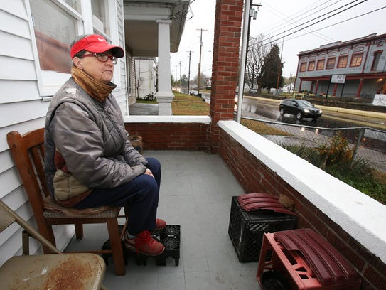 Sharon Trager watches traffic outside her rental unit