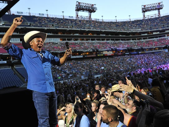 Neal McCoy gets close to his fans at the 2015 CMA Music