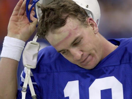 Peyton Manning is disgusted as he pulls off his helmet