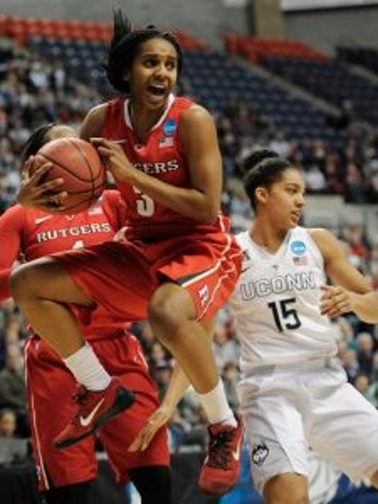 Rutgers guard Tyler Scaife, pulls down a defensive rebound against Connecticut?s Gabby Williams, right, during the first half of a college basketball game in the second round of the NCAA tournament Monday, March 23, 2015, in Storrs, Conn. (AP Photo/Jessica Hill)(Photo: AP)