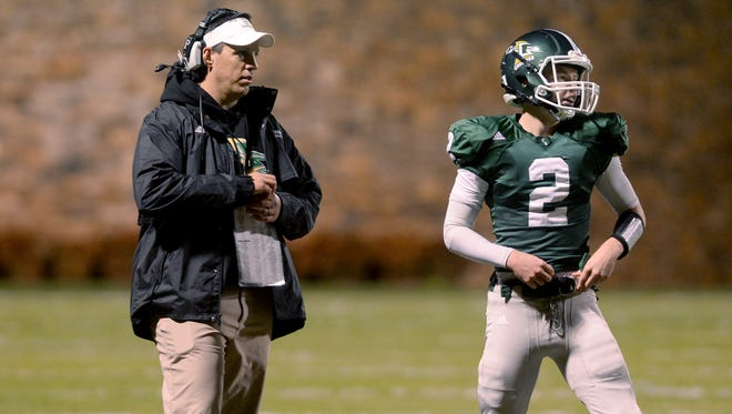 Christ School football coach Mark Moroz and Drew Johnson.