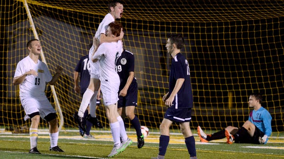 Brendan Mann leaps into the arms of Izaiah Vignali after scoring a 2015 goal. Mann is a returning all-state selection for the Rockets.