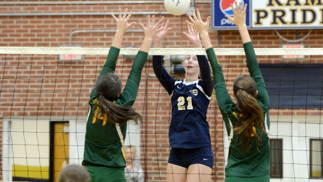 Roberson junior Abby Krueger (21) has committed to play college volleyball for Wake Forest.