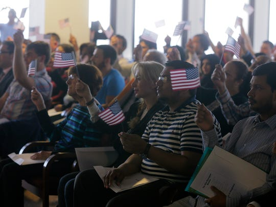 New citizens of the United States participate in a
