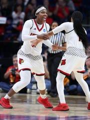 LouisvilleÕs Myisha Hines-Allen (2) and Arica Carter