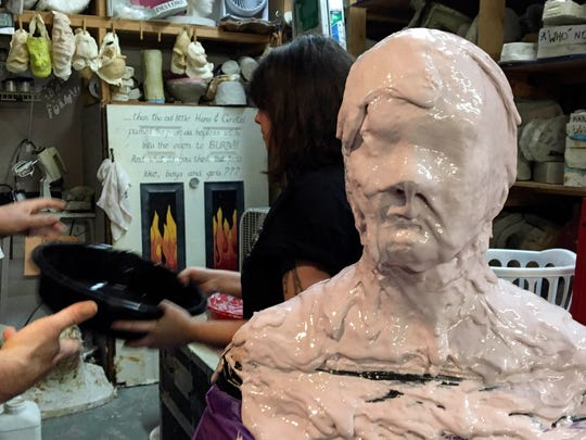 Ashley Green, Alan Ostrander and Ray Asiala of AEO Studios do a lifecast mold of Christina LaFortune's head.
