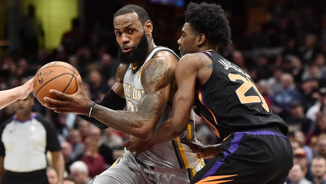 Mar 23, 2018; Cleveland, OH, USA; Cleveland Cavaliers forward LeBron James (23) drives to the basket against Phoenix Suns guard Josh Jackson (20) during the first half at Quicken Loans Arena. Mandatory Credit: Ken Blaze-USA TODAY Sports