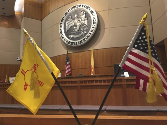 New Mexico state flags are raised in the New Mexico state Senate in Santa Fe .