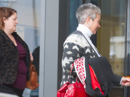 Janice Laird, left, and Kim Swartz, York City School District teachers, enter the York Country Judicial Center for a day of testimony in the York City Schools receivership case Tuesday.