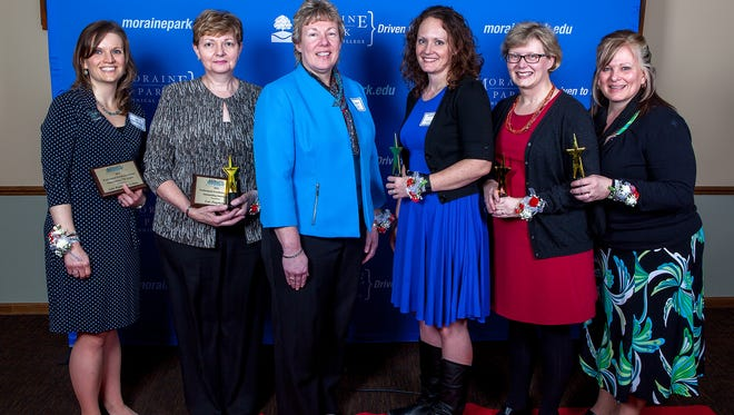 Five Moraine Park Technical College staff members were recognized during the annual MPACTE awards banquet. From left are: Julie Waldvogel-Leitner, Outstanding CTE Leader; Lois Zingsheim, Outstanding Instructor; Bonnie Baerwald, Moraine Park president and award presenter; Emily Hayes, Outstanding New Instructor; Anne Lemke, Outstanding Member-Community Involvement; and Katrina Dudzinski, Outstanding Support Professional.
