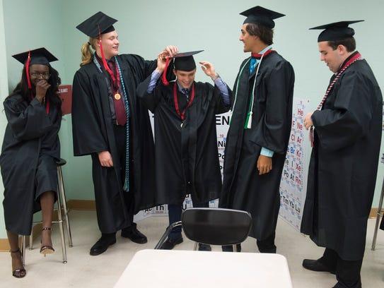 Graduates (from left) Rai'me Weaver, 18, of Hobe Sound,
