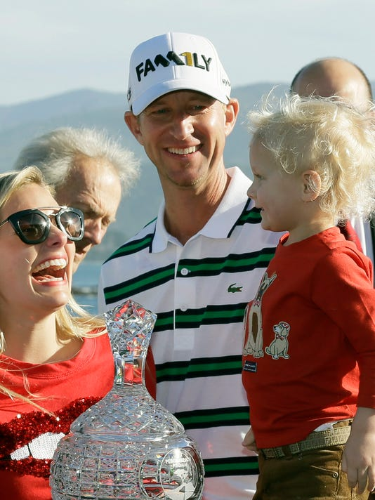 FILE - In this Feb. 14, 2016, file photo, Vaughn Taylor, center, smiles after winning the AT&T Pebble Beach National Pro-Am golf tournament as he stands with his two-year-old son, Locklyn, and wife Leot, in Pebble Beach, Calif. Just like that, Taylor went from 447th in the world rankings to a spot in the Masters. (AP Photo/Eric Risberg, File)