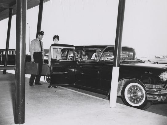 A family arrives at the airport in style, around 1955.