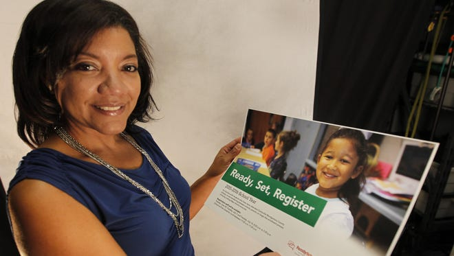 Clarksville-Montgomery County School System's parent engagement specialist Esperanza Soriano-McCrary holds a sign to let parents know how to get involved. This is Soriano-McCrary's second year in the position.