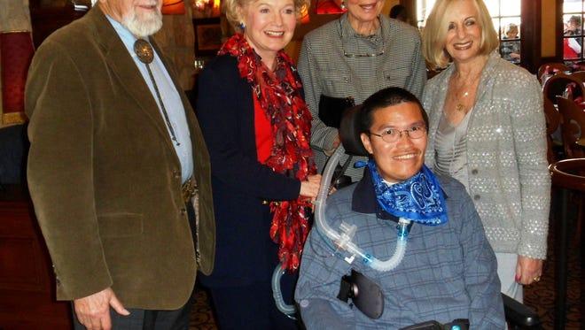 Angel View board member Henry Kotzen, sponsors Patty Newman, Donna MacMillan, Helene Galen and client Peter Li