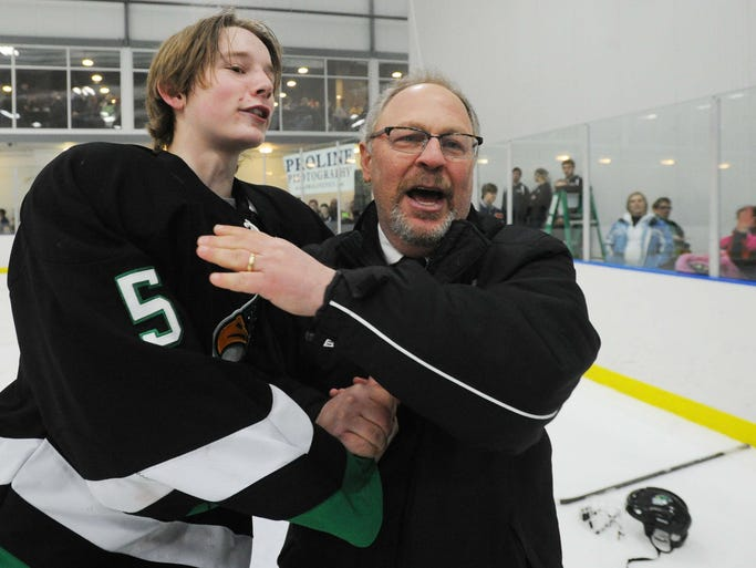Zach Babb and Kravitz celebrate on the ice after the win. Bob Kravitz, goaltender coach for the Zionsville Arctic Eagles high school hockey team is seen as his team defeats the Penn Kingsman team 4-1 for the 3A state hockey championship in Ft. Wayne Saturday March 8, 2014.